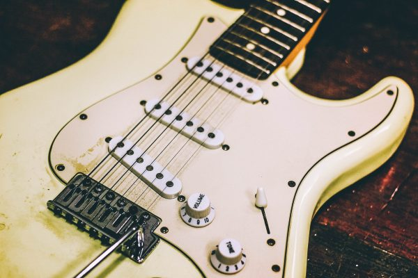 Showing the front body of a Fender Stratocaster electric guitar